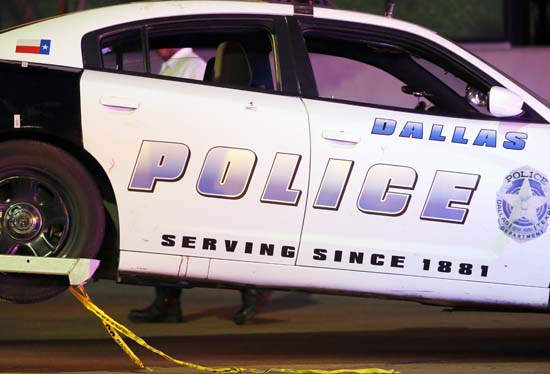 <div class='meta'><div class='origin-logo' data-origin='AP'></div><span class='caption-text' data-credit='AP Photo/Tony Gutierrez'>A Dallas police vehicle that has damage to the upper rear door and a red fluid stain beneath the same door is hauled away from the Baylor University Medical Center emergency room</span></div>