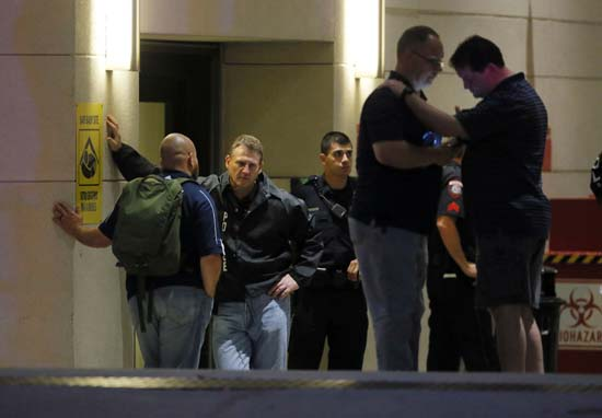 <div class='meta'><div class='origin-logo' data-origin='AP'></div><span class='caption-text' data-credit='AP Photo/Tony Gutierrez'>Law enforcement officials wait outside the emergency room entrance at Baylor University Medical Center</span></div>