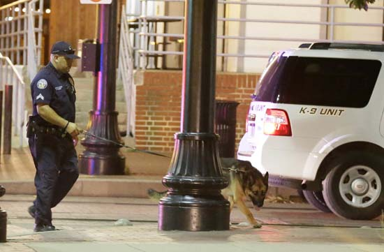 <div class='meta'><div class='origin-logo' data-origin='AP'></div><span class='caption-text' data-credit='AP Photo/LM Otero'>Law enforcement sweeps the area for explosives after a shooting in downtown Dallas</span></div>