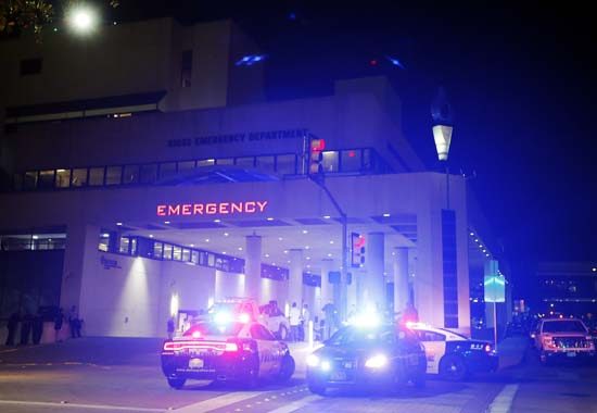 <div class='meta'><div class='origin-logo' data-origin='AP'></div><span class='caption-text' data-credit='AP Photo/Tony Gutierrez'>Emergency responder vehicles sit outside of the emergency room at Baylor University Medical Center</span></div>