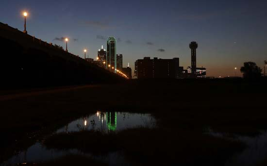 <div class='meta'><div class='origin-logo' data-origin='AP'></div><span class='caption-text' data-credit='AP Photo/Eric Gay'>Reunion tower, right, stands with the lights out as the sun rises over downtown Dallas</span></div>
