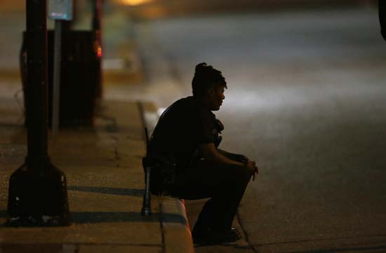 <div class='meta'><div class='origin-logo' data-origin='AP'></div><span class='caption-text' data-credit='AP Photo/LM Otero'>A Dallas police officer, who did not wish to be identified, takes a moment as she guards an intersection</span></div>