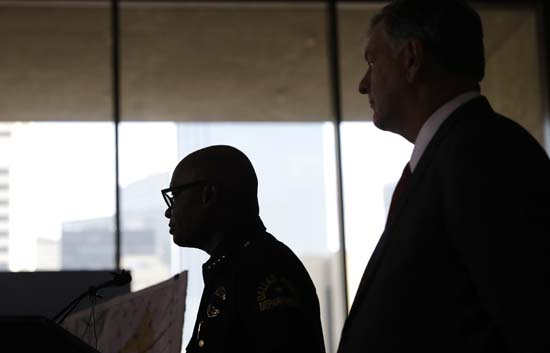 <div class='meta'><div class='origin-logo' data-origin='AP'></div><span class='caption-text' data-credit='AP Photo/Eric Gay'>Dallas police chief David Brownand Dallas mayor Mike Rawlings, right</span></div>