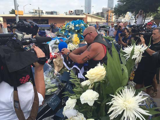 <div class='meta'><div class='origin-logo' data-origin='AP'></div><span class='caption-text' data-credit='KTRK'>The memorial for the fallen Dallas officers is growing outside police headquarters.</span></div>