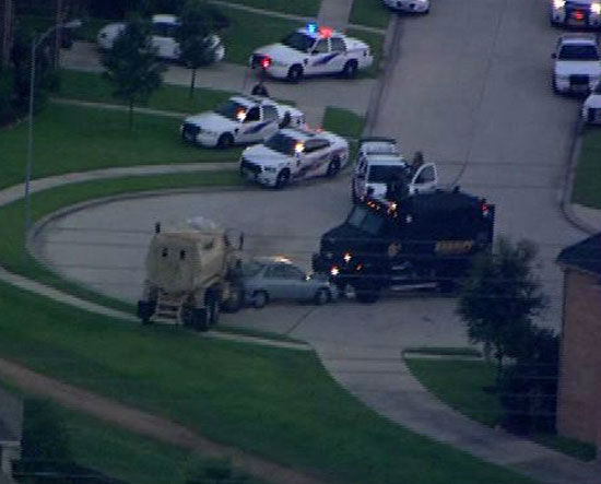 <div class='meta'><div class='origin-logo' data-origin='none'></div><span class='caption-text' data-credit='Photo/ABC-13'>These are photos from a tense standoff in north Harris County after six people were killed and another wounded, Wednesday, July 9.</span></div>