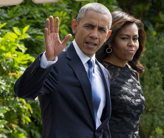 <div class='meta'><div class='origin-logo' data-origin='AP'></div><span class='caption-text' data-credit='AP Photo/Pablo Martinez Monsivais'>President Barack Obama and first lady Michelle Obama</span></div>