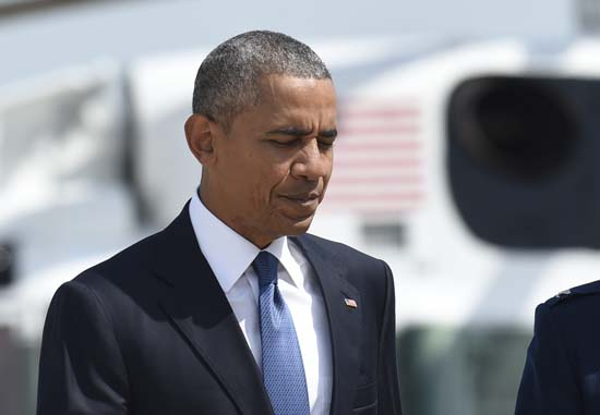 <div class='meta'><div class='origin-logo' data-origin='AP'></div><span class='caption-text' data-credit='AP Photo/Susan Walsh'>President Barack Obama heads to Air Force One at Andrews Air Force Base in Md.</span></div>