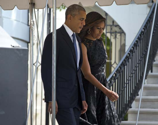 <div class='meta'><div class='origin-logo' data-origin='AP'></div><span class='caption-text' data-credit='AP Photo/Pablo Martinez Monsivais'>President Barack Obama and first lady Michelle Obama walk out of the White House in Washington</span></div>