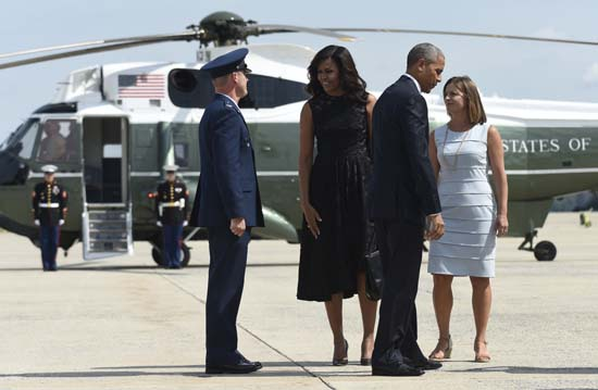 <div class='meta'><div class='origin-logo' data-origin='AP'></div><span class='caption-text' data-credit='AP Photo/Susan Walsh'>President Barack Obama and first lady Michelle Obama prepare to walk up the steps of Air Force One at Andrews Air Force Base in Md.</span></div>