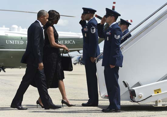 <div class='meta'><div class='origin-logo' data-origin='AP'></div><span class='caption-text' data-credit='AP Photo/Susan Walsh'>President Barack Obama and first lady Michelle Obama walk up the steps of Air Force One at Andrews Air Force Base</span></div>