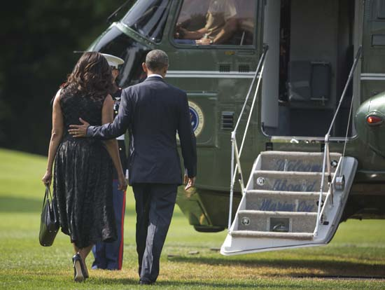 <div class='meta'><div class='origin-logo' data-origin='AP'></div><span class='caption-text' data-credit='AP Photo/Pablo Martinez Monsivais'>President Barack Obama and first lady Michelle Obama walk across the South Lawn of the White House in Washington</span></div>