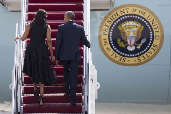 <div class='meta'><div class='origin-logo' data-origin='AP'></div><span class='caption-text' data-credit='AP Photo/Evan Vucci'>President Barack Obama and first lady Michelle Obama board Air Force One at Andrews Air Force Base</span></div>