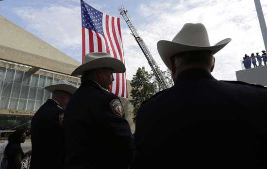 <div class='meta'><div class='origin-logo' data-origin='AP'></div><span class='caption-text' data-credit='AP Photo/Eric Gay'>Members of law enforcement wait to enter the Morton H. Meyerson Symphony Center for a memorial for fallen police officers</span></div>