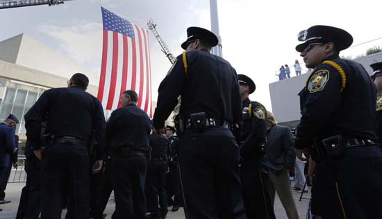 <div class='meta'><div class='origin-logo' data-origin='AP'></div><span class='caption-text' data-credit='AP Photo/Eric Gay'>Members of law enforcement wait to enter the Morton H. Meyerson Symphony Center</span></div>