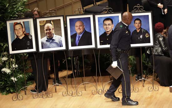 <div class='meta'><div class='origin-logo' data-origin='AP'></div><span class='caption-text' data-credit='AP Photo/Eric Gay'>Portraits of five fallen officers are arranged prior to a memorial service at the Morton H. Meyerson Symphony Center</span></div>