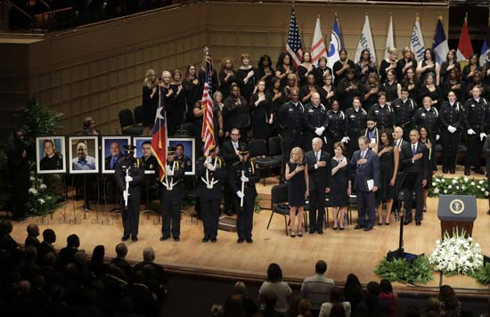 <div class='meta'><div class='origin-logo' data-origin='AP'></div><span class='caption-text' data-credit='AP Photo/Eric Gay'>Officials stand for the National anthem during a memorial service at the Morton H. Meyerson Symphony Center</span></div>