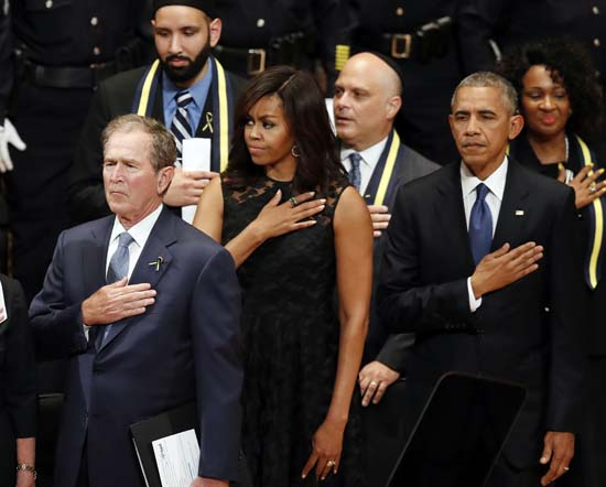 <div class='meta'><div class='origin-logo' data-origin='AP'></div><span class='caption-text' data-credit='AP Photo/Eric Gay'>From left, former president George W. Bush, first lady Michelle Obama and President Barack Obama</span></div>