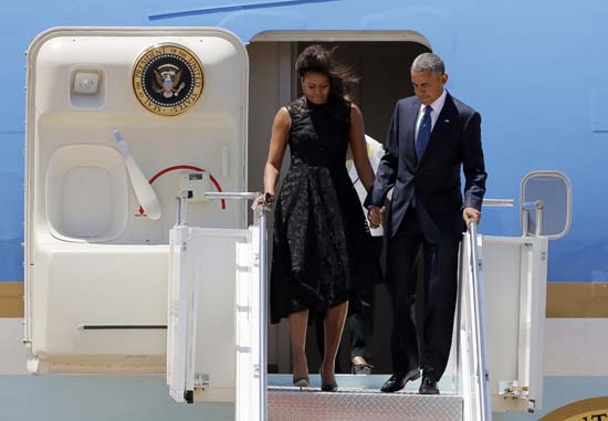 <div class='meta'><div class='origin-logo' data-origin='AP'></div><span class='caption-text' data-credit='AP Photo/Tony Gutierrez'>President Barack Obama and first lady Michelle Obama arrive on Air Force One at Dallas Love Field</span></div>