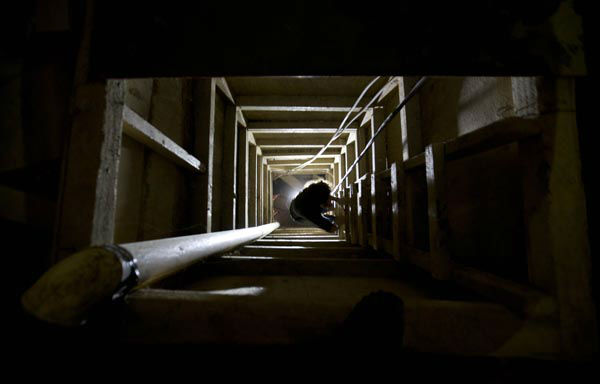 <div class='meta'><div class='origin-logo' data-origin='none'></div><span class='caption-text' data-credit='AP Photo/ Eduardo Verdugo'>A journalist climbs a ladder to get out of the tunnel that according to authorities, drug lord Joaquin &#34;El Chapo&#34; Guzman used to escape from the Altiplano maximum security prison</span></div>