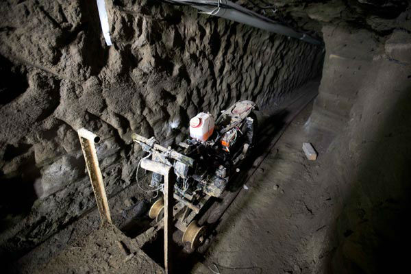 <div class='meta'><div class='origin-logo' data-origin='none'></div><span class='caption-text' data-credit='AP Photo/ Eduardo Verdugo'>A motorcycle adapted to a rail sits in the tunnel under the half-built house where according to authorities, drug lord Joaquin &#34;El Chapo&#34; Guzman made his escape</span></div>