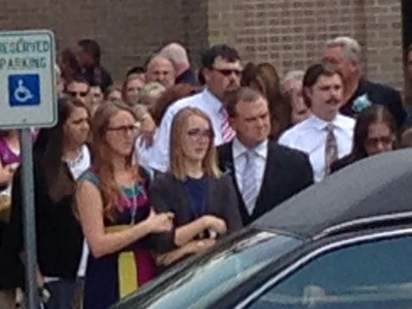 Cassidy Stay in tears outside church as caskets wheeled out. <span class=meta>Photo/ABC-13</span>