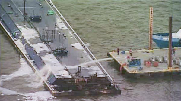 <div class='meta'><div class='origin-logo' data-origin='none'></div><span class='caption-text' data-credit='KTRK Photo'>One of the barges, which is hauling petroleum naphtha, caught fire following the collision. An HFD fire boat put out those flames</span></div>