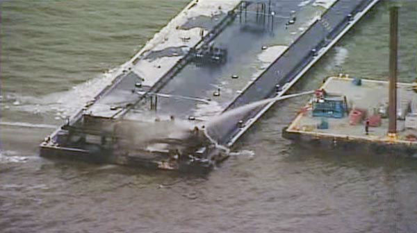 <div class='meta'><div class='origin-logo' data-origin='none'></div><span class='caption-text' data-credit='KTRK Photo'>One of the barges, which is hauling petroleum naphtha, caught fire following the collision. An HFD fire boat put out those flames.</span></div>
