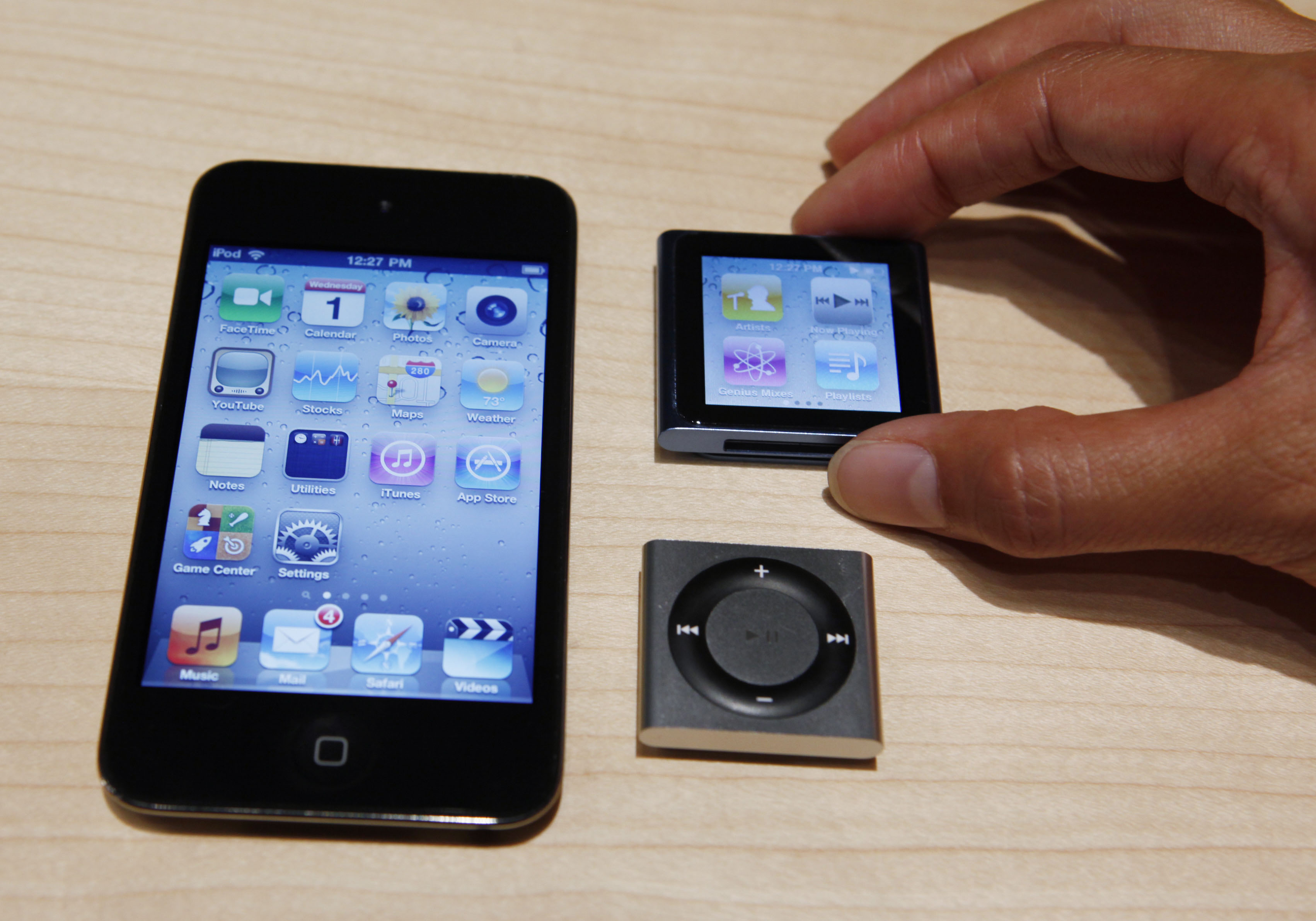 <div class='meta'><div class='origin-logo' data-origin='AP'></div><span class='caption-text' data-credit='AP Photo/Paul Sakuma'>An Apple employee holds a new Apple iPod Nano, upper right, as the new Ipod Shuffle, bottom right, and iPod Touch, left, are shown, Wednesday, Sept. 1, 2010, in San Francisco.</span></div>