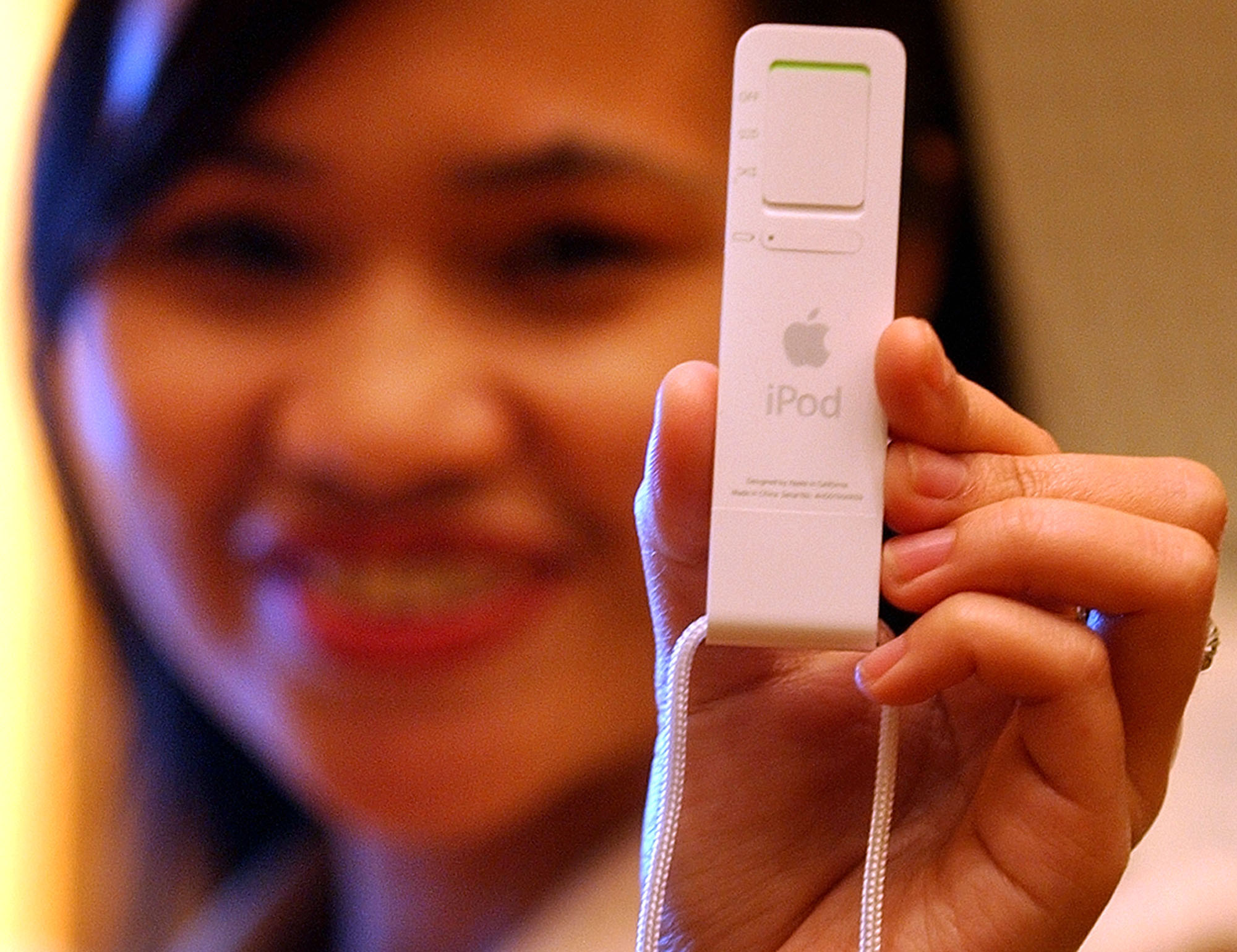<div class='meta'><div class='origin-logo' data-origin='AP'></div><span class='caption-text' data-credit='AP Photo/Aaron Favila'>Vivian Pasia, a sales manager for a company that distributes Mac products, shows the new Apple iPod Shuffle on Tuesday, Jan. 25, 2005.</span></div>