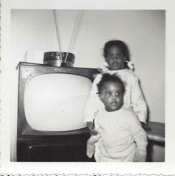 "<div class=""meta image-caption""><div class=""origin-logo origin-image none""><span>none</span></div><span class=""caption-text"">Melanie Lawson with her little sister - notice the big tube TV! (KTRK Photo)</span></div>"