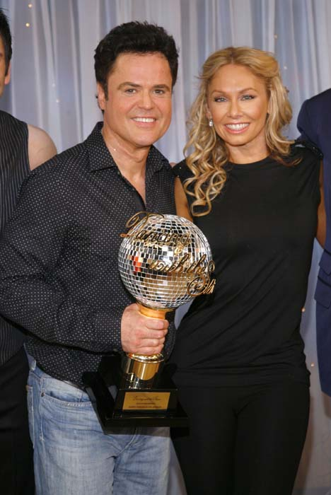 <div class='meta'><div class='origin-logo' data-origin='AP'></div><span class='caption-text' data-credit='AP Photo/Andy Kropa'>Donny Osmond, left, and his partner Kym Johnson, won &#34;Dancing with the Stars&#34;</span></div>