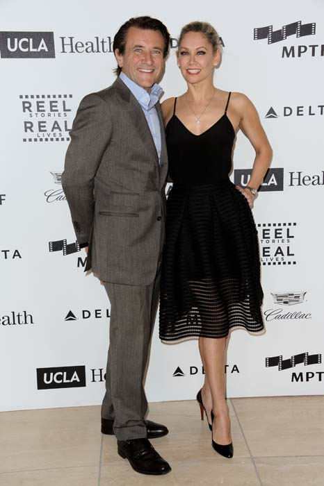 <div class='meta'><div class='origin-logo' data-origin='AP'></div><span class='caption-text' data-credit='Richard Shotwell/Invision/AP'>Robert Herjavec, left, and Kym Johnson arrive at the 4th Annual Reel Stories, Real Lives Benefit held at Milk Studios in Los Angeles.</span></div>