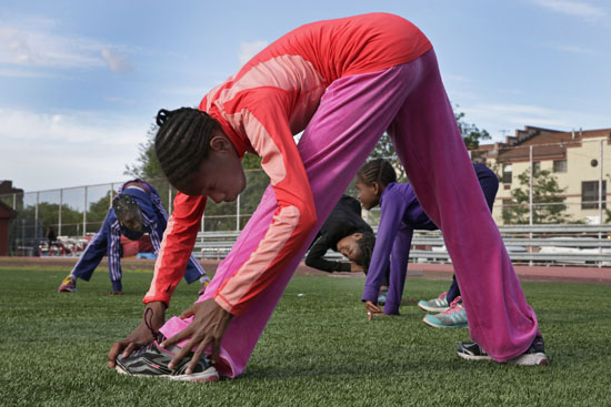 "<div class=""meta image-caption""><div class=""origin-logo origin-image ap""><span>AP</span></div><span class=""caption-text"">In this July 11, 2016 photo, Tai Sheppard, 11, foreground, does warm-up stretches with sisters Rainn Sheppard, 10, and Brooke Sheppard, 8. (Richard Drew)</span></div>"