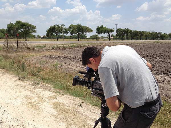Reporter Ted Oberg preparing to go live for a report outside of the Border Patrol headquarters in McAllen <span class=meta></span>
