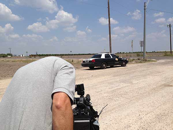 Reporter Ted Oberg and photographer Dave Aguillard are on a road outside of McAllen near the Rio Bravo River, which marks the Texas-Mexico border. <span class=meta></span>