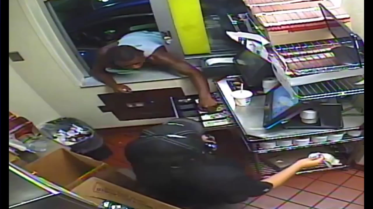 <div class='meta'><div class='origin-logo' data-origin='none'></div><span class='caption-text' data-credit='Houston Police Department'>Houston police are looking for a robber suspected in a handful of fast food holdups around the north side of the city in July 2017.</span></div>