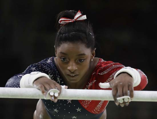 <div class='meta'><div class='origin-logo' data-origin='AP'></div><span class='caption-text' data-credit='AP Photo/Julio Cortez'>United States' Simone Biles performs on the uneven bars</span></div>