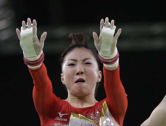 <div class='meta'><div class='origin-logo' data-origin='AP'></div><span class='caption-text' data-credit='AP Photo/Julio Cortez'>Japan's Asuka Teramoto performs on the uneven bars</span></div>