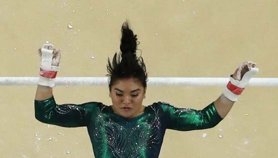"<div class=""meta image-caption""><div class=""origin-logo origin-image ap""><span>AP</span></div><span class=""caption-text"">Mexico's Alexa Moreno performs on the uneven bars (AP Photo/Morry Gash)</span></div>"