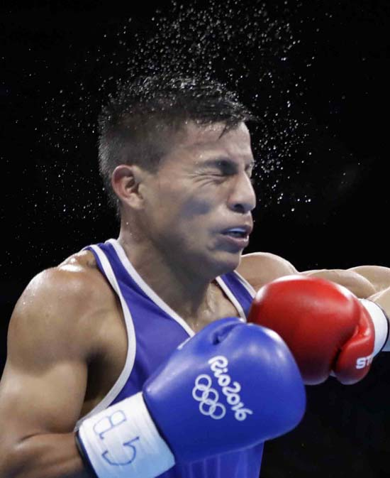 <div class='meta'><div class='origin-logo' data-origin='AP'></div><span class='caption-text' data-credit='AP Photo/Frank Franklin II'>Ecuador's Carlos Eduardo Quipo Pilataxi during a men's light flyweight preliminary boxing match</span></div>