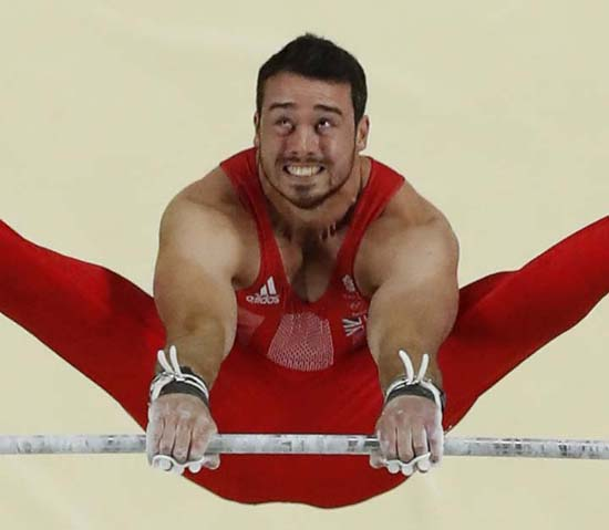 <div class='meta'><div class='origin-logo' data-origin='AP'></div><span class='caption-text' data-credit='AP Photo/Tim Donnelly'>Britain's Kristian Thomas performs on the horizontal bar</span></div>