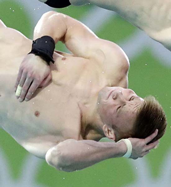 <div class='meta'><div class='origin-logo' data-origin='AP'></div><span class='caption-text' data-credit='AP Photo/Wong Maye-E'>United States' Steele Johnsoncompete in the men's synchronized diving final</span></div>