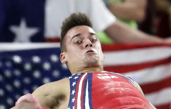 <div class='meta'><div class='origin-logo' data-origin='AP'></div><span class='caption-text' data-credit='AP Photo/Dmitri Lovetsky'>United States' Sam Mikulak performs on the horizontal bar</span></div>