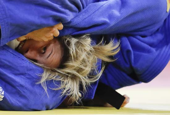 "<div class=""meta image-caption""><div class=""origin-logo origin-image ap""><span>AP</span></div><span class=""caption-text"">Portugal's Telma Monteiroite competes in judo competition (AP)</span></div>"