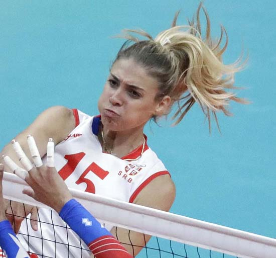 <div class='meta'><div class='origin-logo' data-origin='AP'></div><span class='caption-text' data-credit='AP Photo/Jeff Roberson'>Serbia's Jovana Stevanovic spikes the ball</span></div>