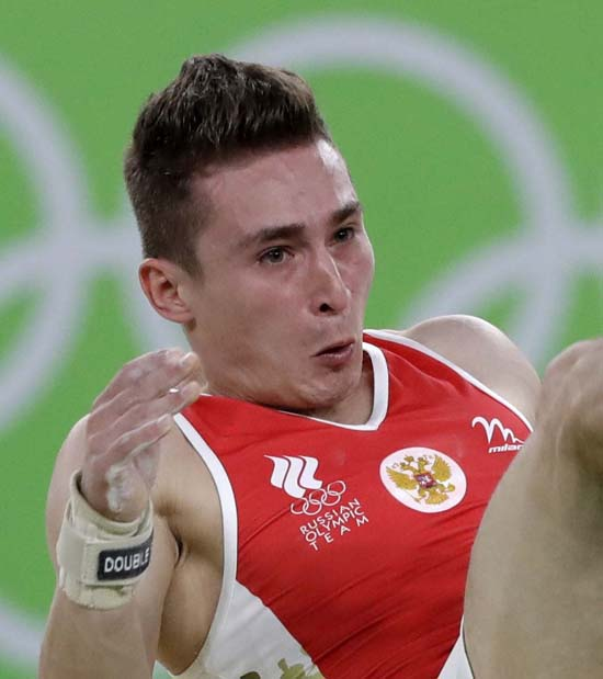 <div class='meta'><div class='origin-logo' data-origin='AP'></div><span class='caption-text' data-credit='AP Photo/Rebecca Blackwell'>Russia's David Belyavskiy performs on the floor</span></div>