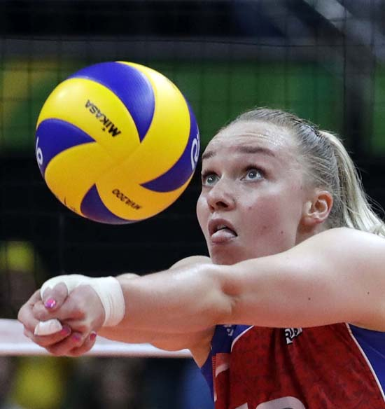 <div class='meta'><div class='origin-logo' data-origin='AP'></div><span class='caption-text' data-credit='AP Photo/Jeff Roberson'>Russia's Ekaterina Kosianenko bumps during a women's preliminary volleyball match</span></div>