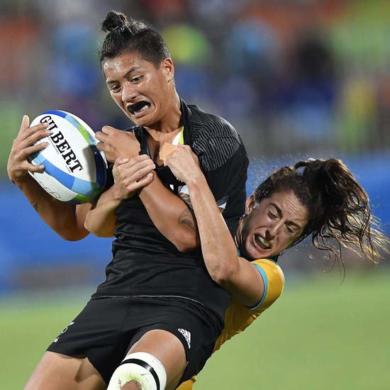 <div class='meta'><div class='origin-logo' data-origin='AP'></div><span class='caption-text' data-credit='Zsolt Czegledi/MTI via AP'>New Zealand's Gayle Broughton, left, is challenged by Australia's Alicia Quirk during the women's rugby match</span></div>
