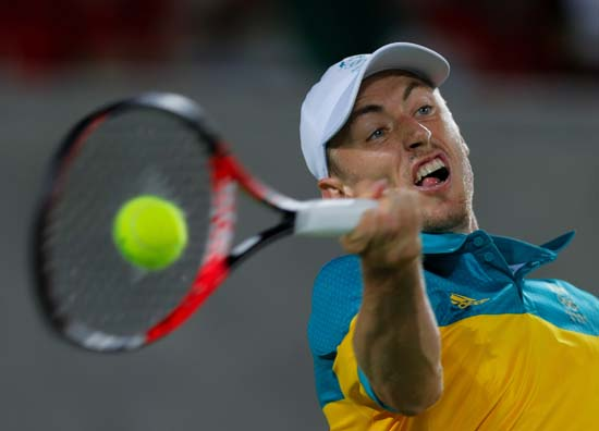 <div class='meta'><div class='origin-logo' data-origin='AP'></div><span class='caption-text' data-credit='AP Photo/Vadim Ghirda'>John Millman, of Australia, returns to Kei Nishikori, of Japan, in the men's tennis competition</span></div>
