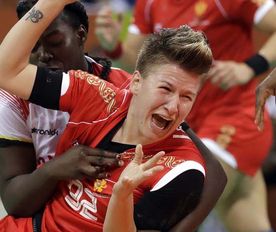 <div class='meta'><div class='origin-logo' data-origin='AP'></div><span class='caption-text' data-credit='AP Photo/Matthias Schrader'>Montenegro's Suzana Lazovic is stopped during the women's preliminary handball match</span></div>